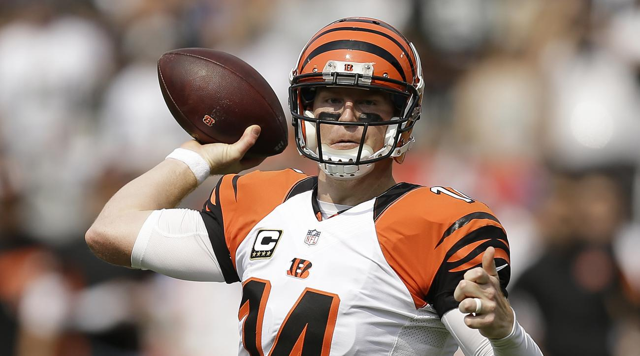 Cincinnati Bengals quarterback Andy Dalton (14) passes against the Oakland Raiders during the first half of an NFL football game in Oakland, Calif., Sunday, Sept. 13, 2015. (AP Photo/Ben Margot)