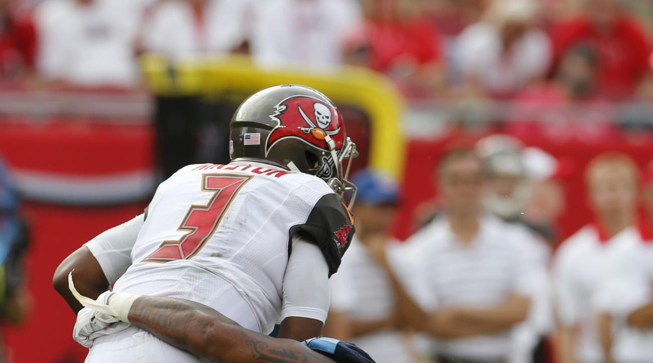 Tampa Bay Buccaneers quarterback Jameis Winston (3) is sacked by Tennessee Titans defensive tackle Jurrell Casey (99) during the second half of an NFL football game, Sunday, Sept. 13, 2015, in Tampa, Fla. (AP Photo/Scott Audette)