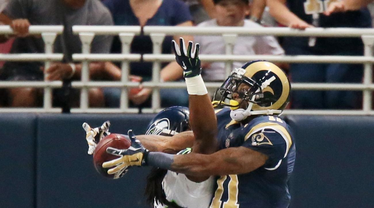 Seattle Seahawks cornerback Richard Sherman (left) breaks up a pass intended for St. Louis Rams wide receiver Tavon Austin in the endzone during the first half of an NFL football game on Sunday, Sept. 13, 2015 in St. Louis. The Rams won 34-31. (Chris Lee/