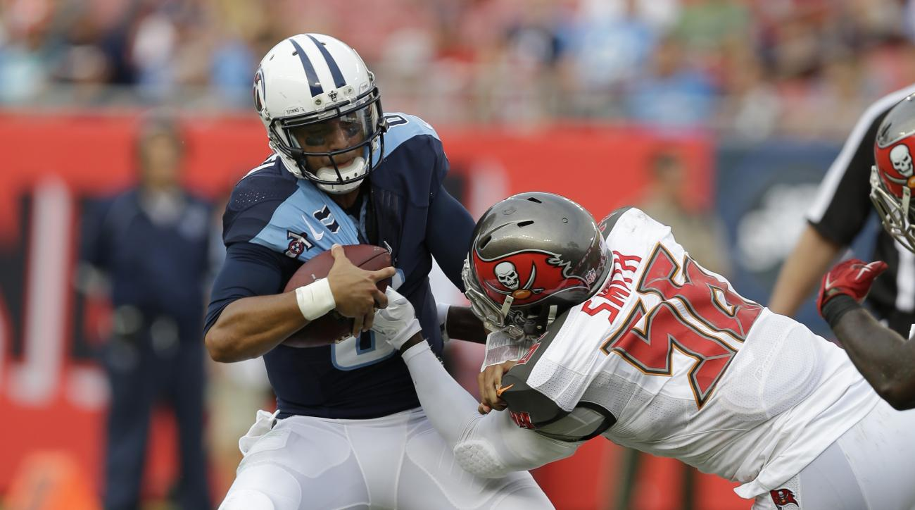 Tennessee Titans quarterback Marcus Mariota (8) is sacked by Tampa Bay Buccaneers defensive end Jacquies Smith (56) during the second half of an NFL football game, Sunday, Sept. 13, 2015, in Tampa, Fla. (AP Photo/Chris O'Meara)