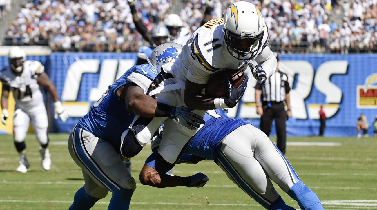 San Diego Chargers wide receiver Steve Johnson (11) leaps into the end zone past Detroit Lions middle linebacker Stephen Tulloch, left, and cornerback Rashean Mathis, right, for a touchdown past during the second half of an NFL football game Sunday, Sept.