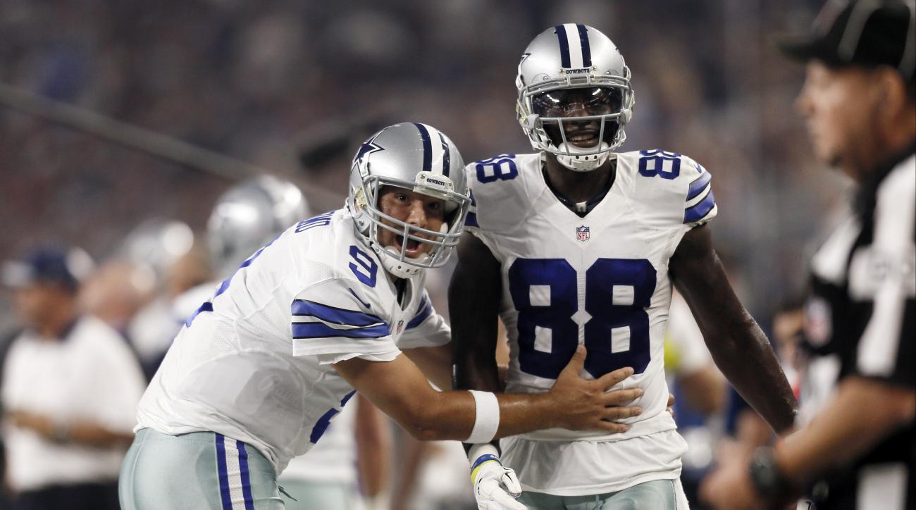 Dallas Cowboys quarterback Tony Romo (9) and wide receiver Dez Bryant (88) react against the New York Giants during the first half of an NFL football game Sunday, Sept. 13, 2015, in Arlington, Texas. (AP Photo/Brandon Wade)