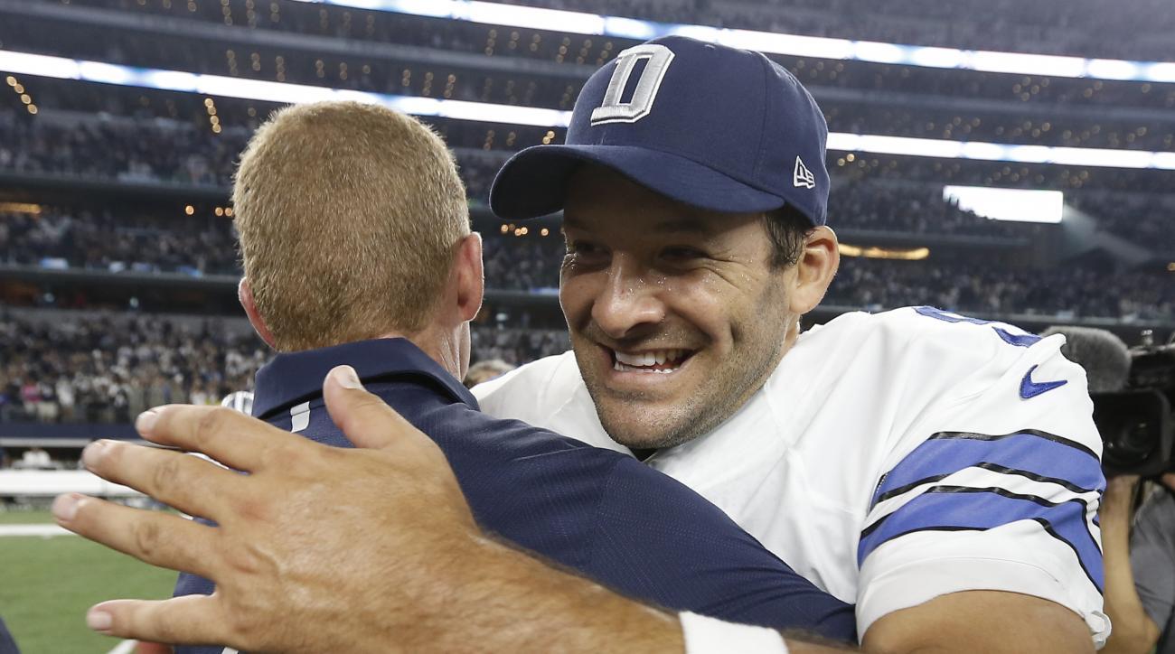Dallas Cowboys quarterback Tony Romo (9) and head coach Jason Garrett embrace after beating New York Giants 27-26 at an NFL football game Sunday, Sept. 13, 2015, in Arlington, Texas. (AP Photo/Brandon Wade)
