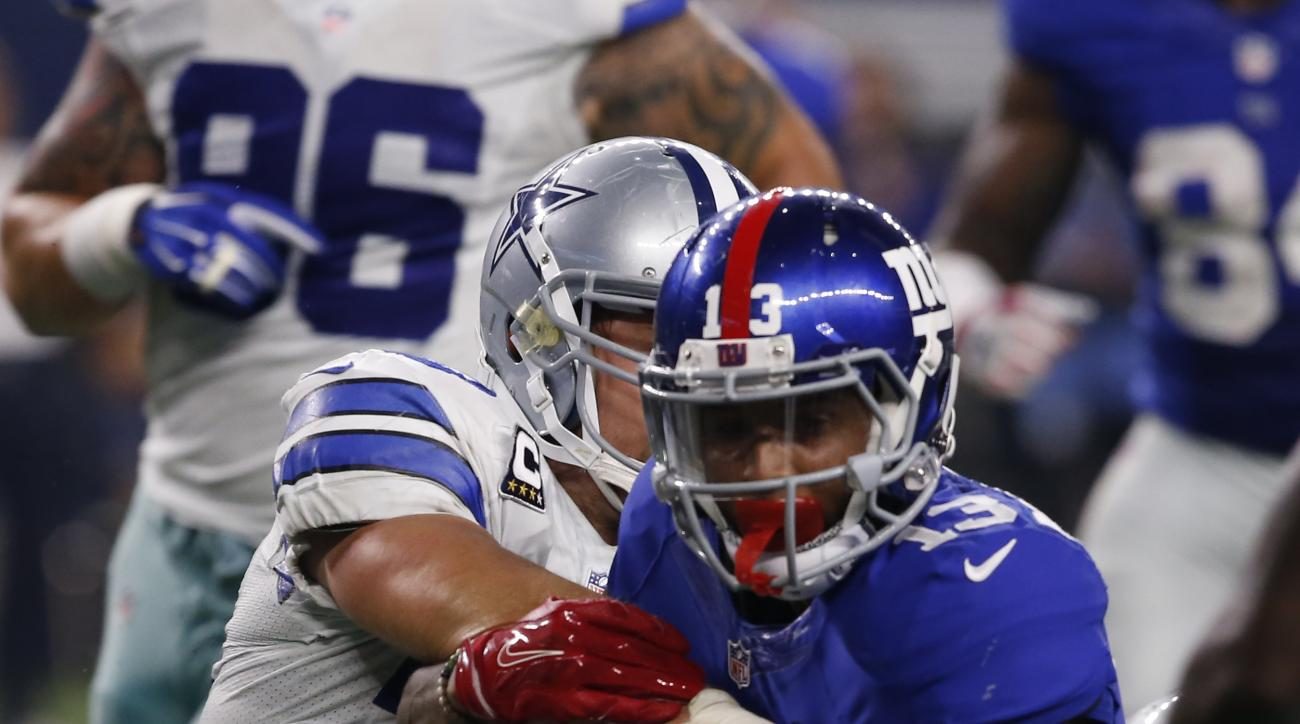 New York Giants wide receiver Odell Beckham (13) is tackled by Dallas Cowboys middle linebacker Sean Lee (50) during the second half of an NFL football game, Sunday, Sept. 13, 2015, in Arlington, Texas. Dallas won 27-26. (Jose Yau/Waco Tribune-Herald via