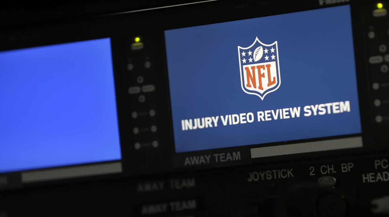 In this photo taken Aug. 29, 2015, part of the video review system for injuries is seen in a box above the field of Met Life Stadium before a pre-season football game between the New York Giants and New York Jets in East Rutherford, N.J. For the first tim