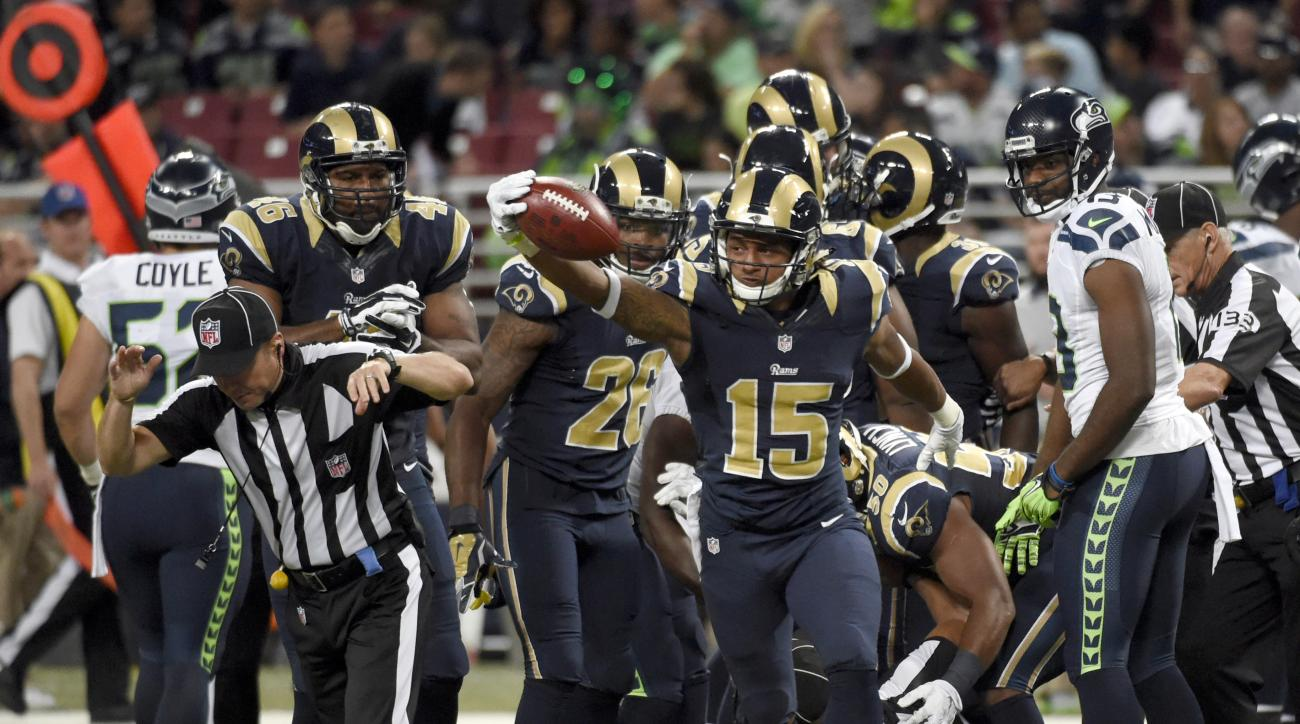 FILE - In this Sunday, Sept. 13, 2015, file photo, St. Louis Rams' Bradley Marquez (15) celebrates after recovering an on-side kick by the Seattle Seahawks during the overtime of an NFL football game in St. Louis. The Seahawks won 34-31 in overtime. (AP P