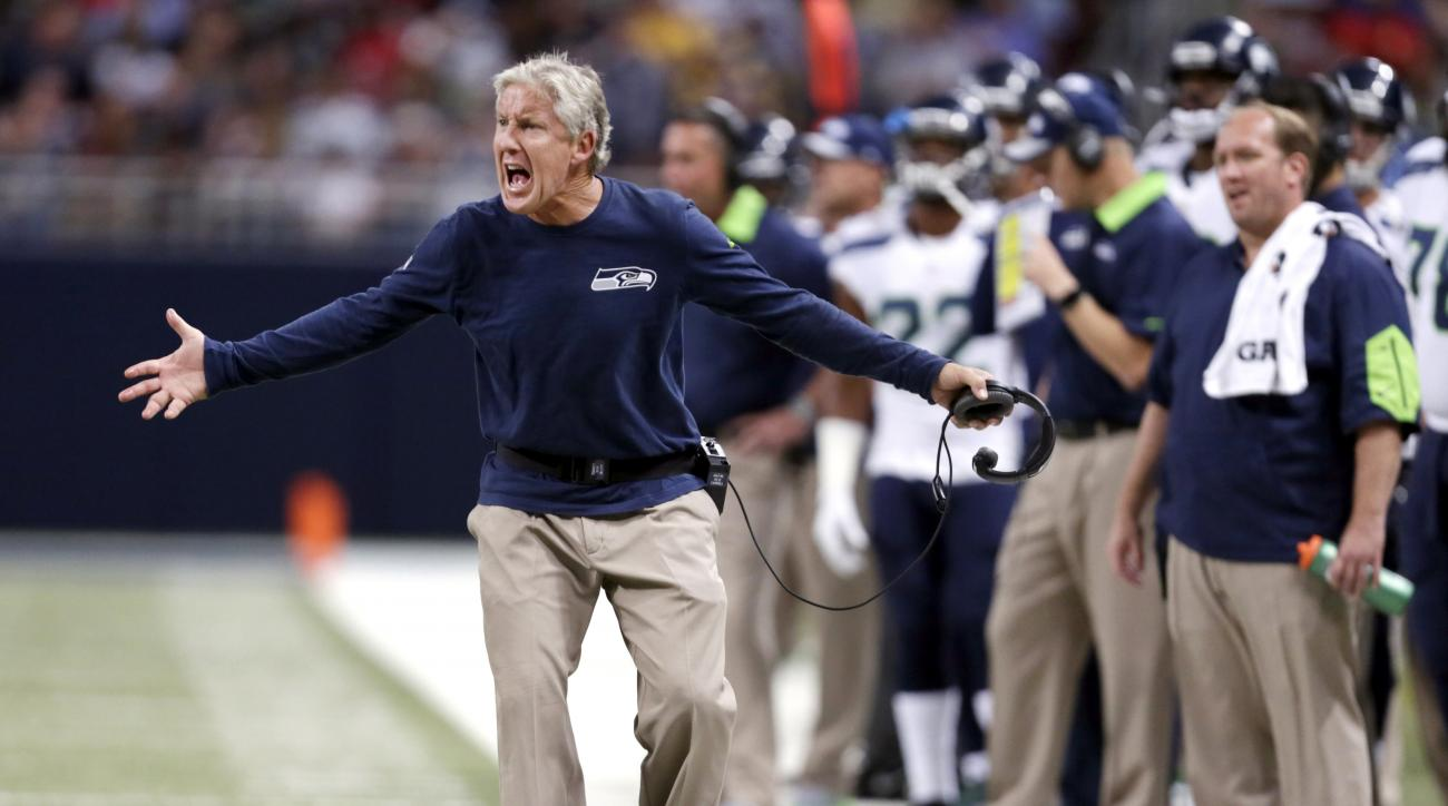 FILE - In this Sunday, Sept. 13, 2015, file photo, Seattle Seahawks head coach Pete Carroll yells from the sideline during the fourth quarter of an NFL football game against the St. Louis Rams in St. Louis. Carroll's decision to start overtime with an ons