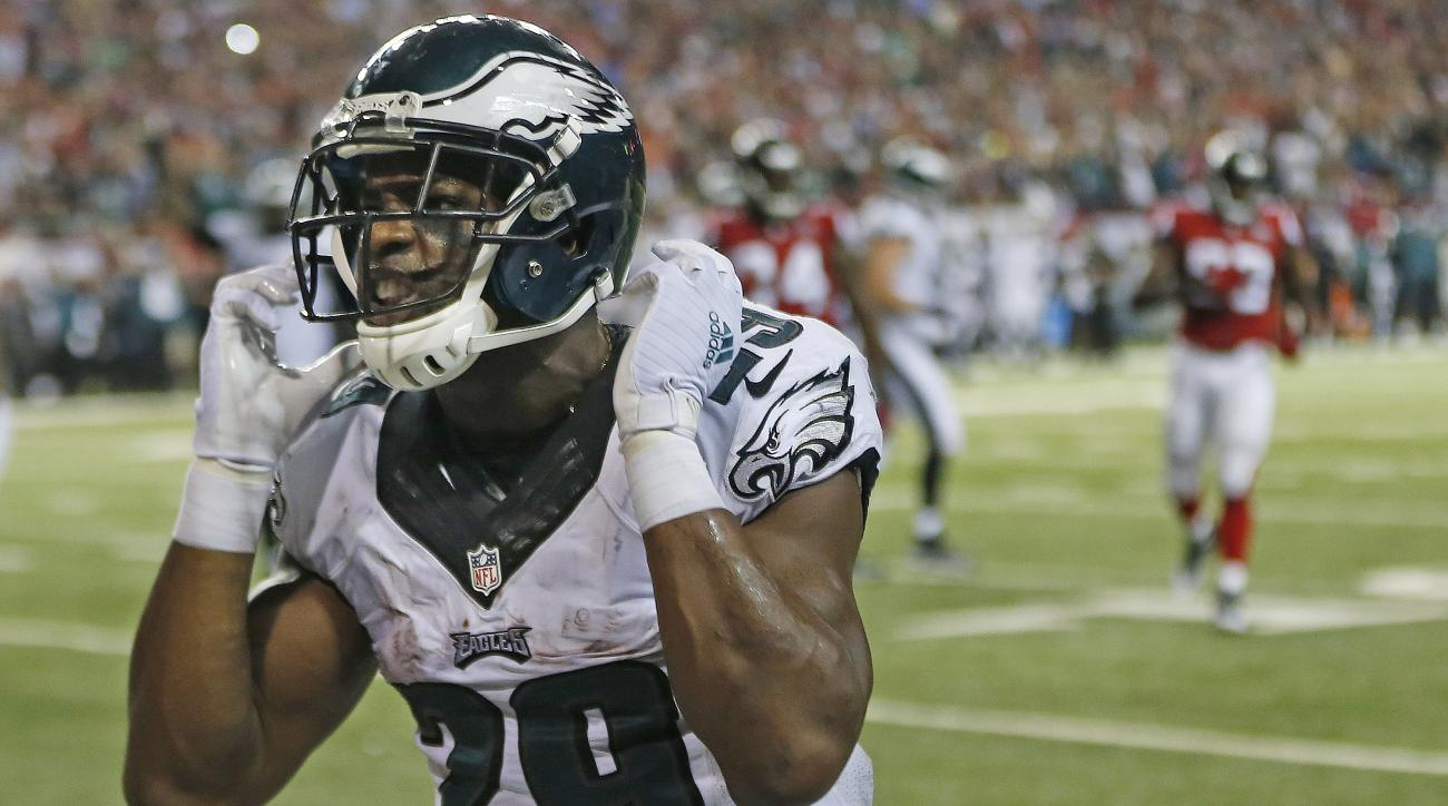 Philadelphia Eagles running back DeMarco Murray (29) celebrates his touchdown against the Atlanta Falcons during the second half of an NFL football game, Monday, Sept. 14, 2015, in Atlanta. (AP Photo/John Bazemore)