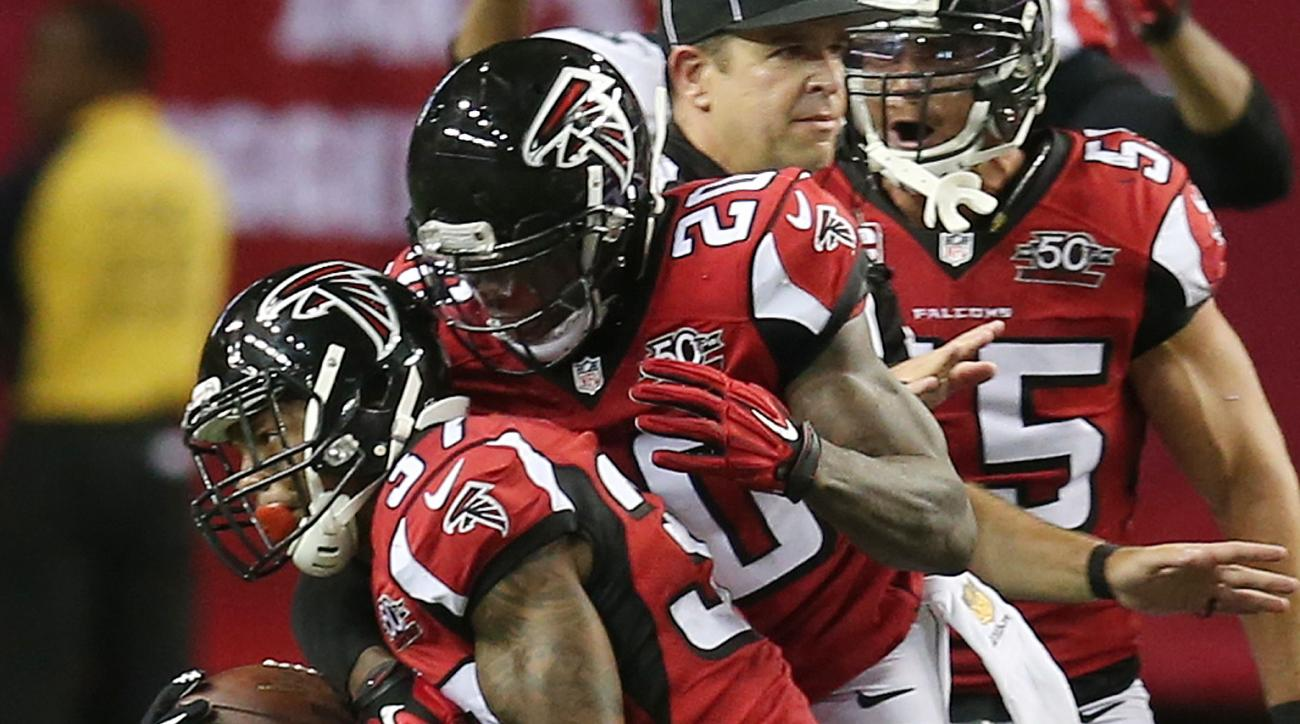 Atlanta Falcons cornerback Ricardo Allen (37) celebrates his interception against the Philadelphia Eagles with Atlanta Falcons defensive back Phillip Adams (20) during the second half of an NFL football game, Monday, Sept. 14, 2015, in Atlanta.   The Atla