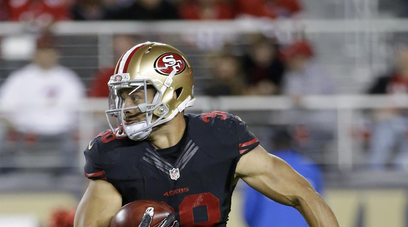 San Francisco 49ers' Jarryd Hayne (38) runs against the Minnesota Vikings during the first half of an NFL football game in Santa Clara, Calif., Monday, Sept. 14, 2015. (AP Photo/Marcio Jose Sanchez)