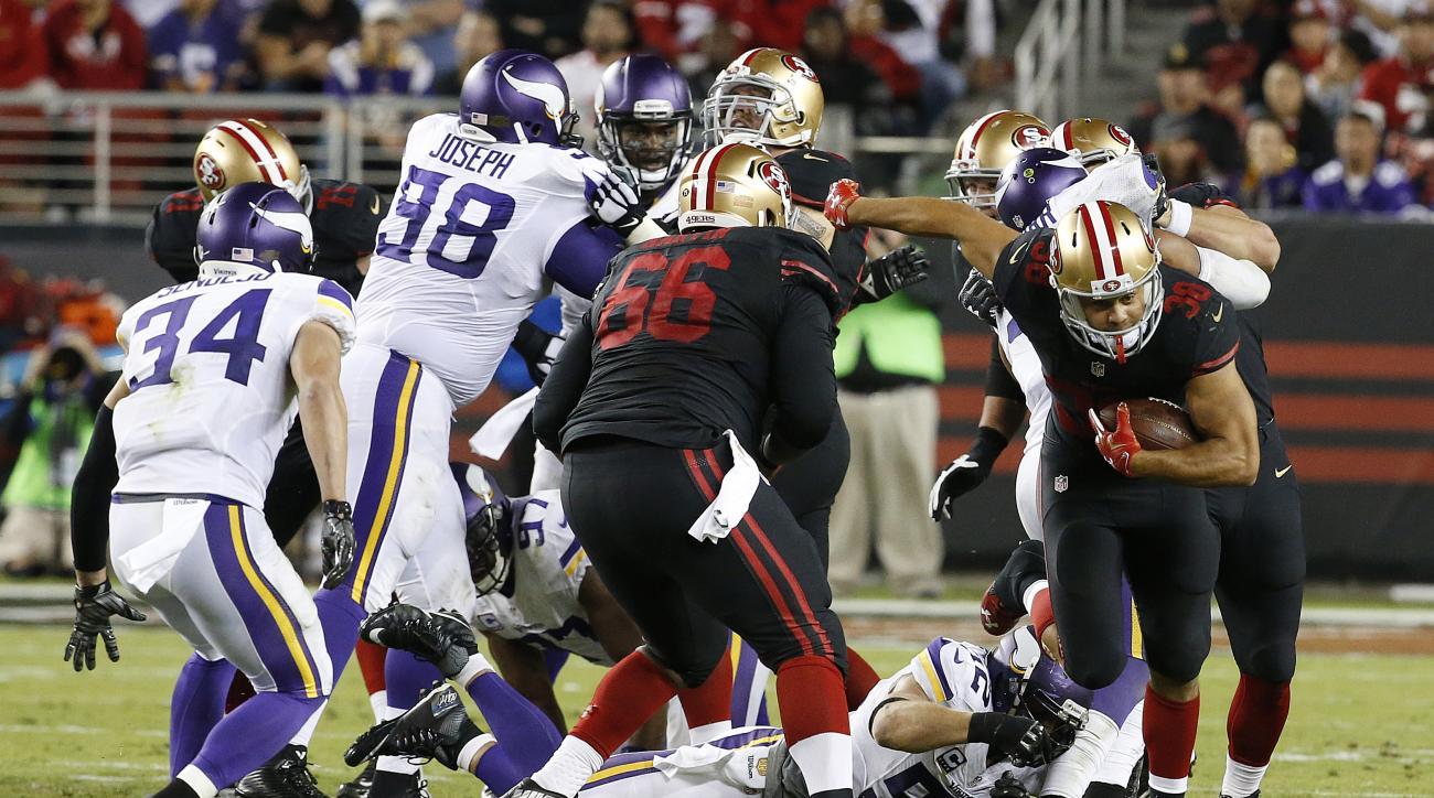 San Francisco 49ers running back Jarryd Hayne, right, runs against the Minnesota Vikings during the second half of an NFL football game in Santa Clara, Calif., Monday, Sept. 14, 2015. (AP Photo/Tony Avelar)