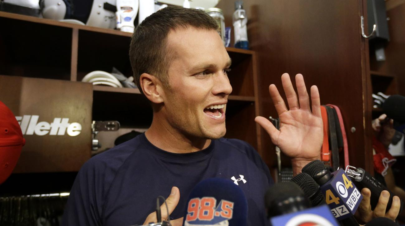 New England Patriots quarterback Tom Brady speaks with members of the media in the locker room before an NFL football practice, Wednesday, Sept. 16, 2015, at Gillette Stadium, in Foxborough, Mass. (AP Photo/Steven Senne)
