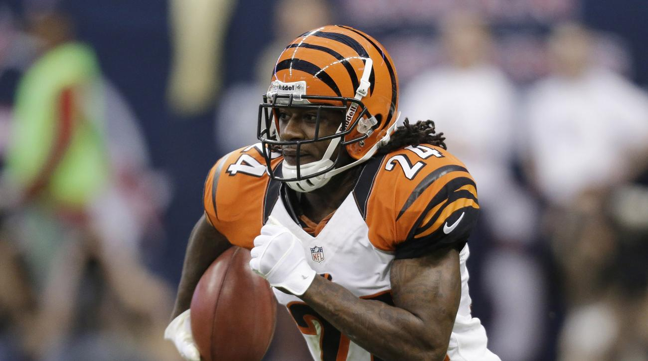 "In this Jan. 5, 2013, file photo, Cincinnati Bengals' Adam Jones runs the ball against the Houston Texans during an NFL wild card playoff football game in Houston. Bengals cornerback Adam ""Pacman"" Jones was fined $35,000 by the NFL for his personal foul a"