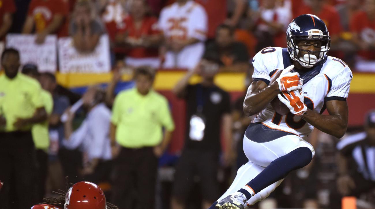 Denver Broncos wide receiver Emmanuel Sanders (10) scores a touchdown past Kansas City Chiefs defensive back Jamell Fleming (30) during the second half of an NFL football game in Kansas City, Mo., Thursday, Sept. 17, 2015. (AP Photo/Ed Zurga)