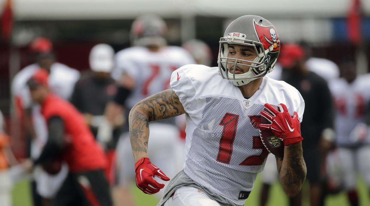 FILE - In this Monday, Aug. 3, 2015 file photo, Tampa Bay Buccaneers wide receiver Mike Evans runs with the football after a reception during a Buccaneers NFL football training camp practice in Tampa, Fla. Injured Tampa Bay receiver Mike Evans hopes to re