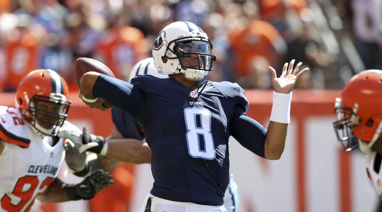 Tennessee Titans quarterback Marcus Mariota(8) throws a pass in the first half of an NFL football game against the Cleveland Browns, Sunday, Sept. 20, 2015, in Cleveland. (AP Photo/Ron Schwane)