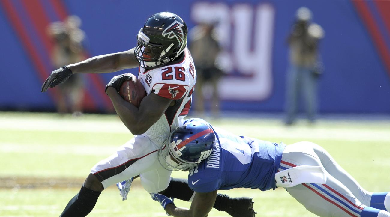 Atlanta Falcons running back Tevin Coleman, left, is tackled by New York Giants cornerback Dominique Rodgers-Cromartie during the first half of an NFL football game, Sunday, Sept. 20, 2015, in East Rutherford, N.J. Both players were hurt on the play and t