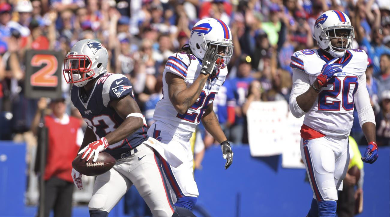 New England Patriots running back Dion Lewis (33) celebrates a touchdown as Buffalo Bills' Ronald Darby (28) and Corey Graham (20) react during the first half of an NFL football game Sunday, Sept. 20, 2015, in Orchard Park, N.Y. (AP Photo/Gary Wiepert)