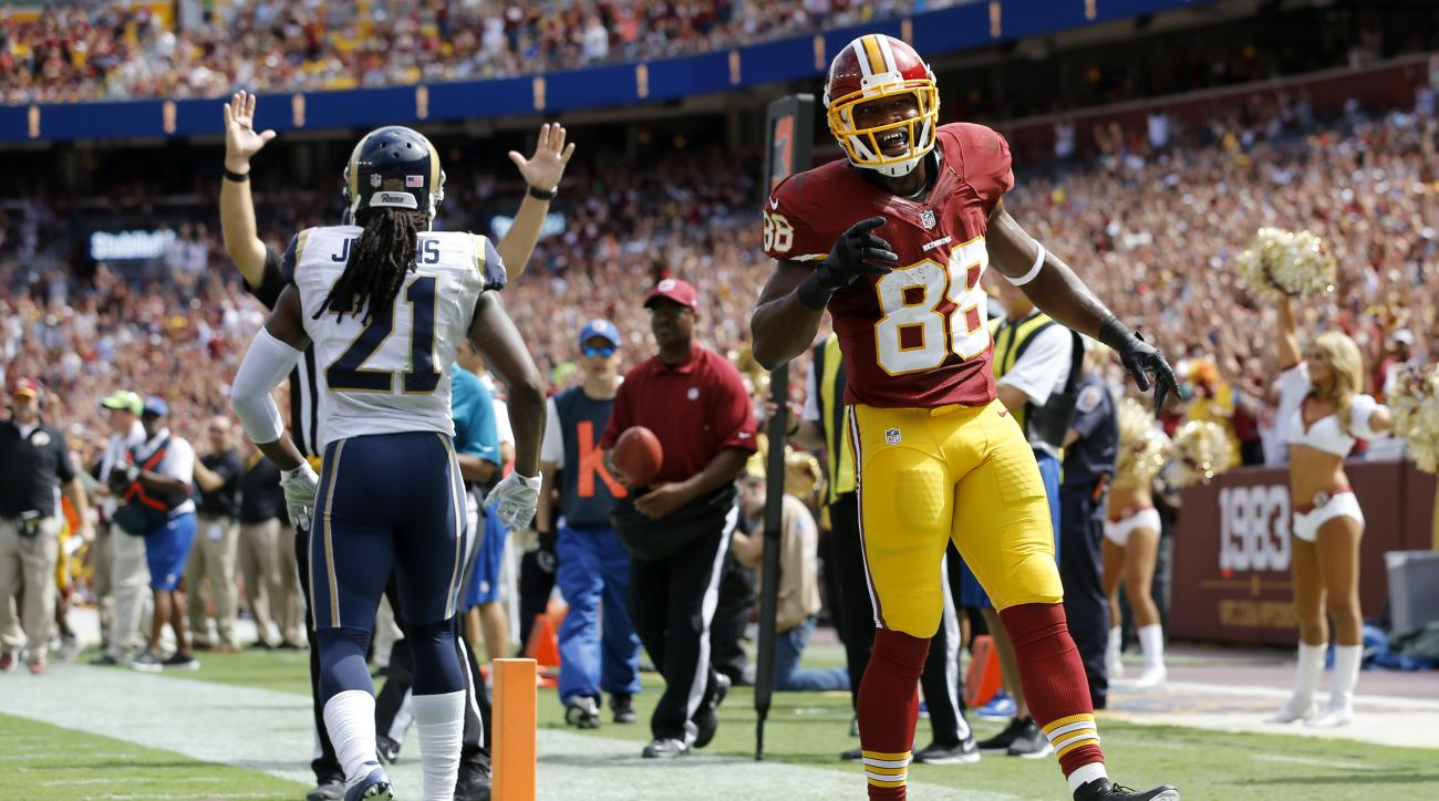 Washington Redskins wide receiver Pierre Garcon (88) celebrates his touchdown as St. Louis Rams cornerback Janoris Jenkins (21) walks away during the first half of an NFL football game in Landover, Md., Sunday, Sept. 20, 2015. (AP Photo/Patrick Semansky)