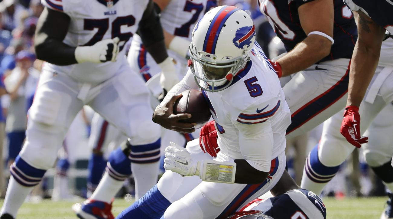 New England Patriots' Chandler Jones (95) sacks Buffalo Bills quarterback Tyrod Taylor (5) during the first half of an NFL football game Sunday, Sept. 20, 2015, in Orchard Park, N.Y. (AP Photo/Bill Wippert)