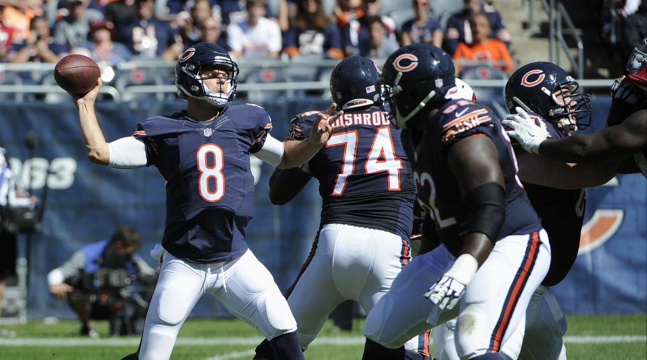 Chicago Bears quarterback Jimmy Clausen (8) throws a pass that was intercepted by Arizona Cardinals cornerback Patrick Peterson during the second half of an NFL football game, Sunday, Sept. 20, 2015, in Chicago. (AP Photo/David Banks)