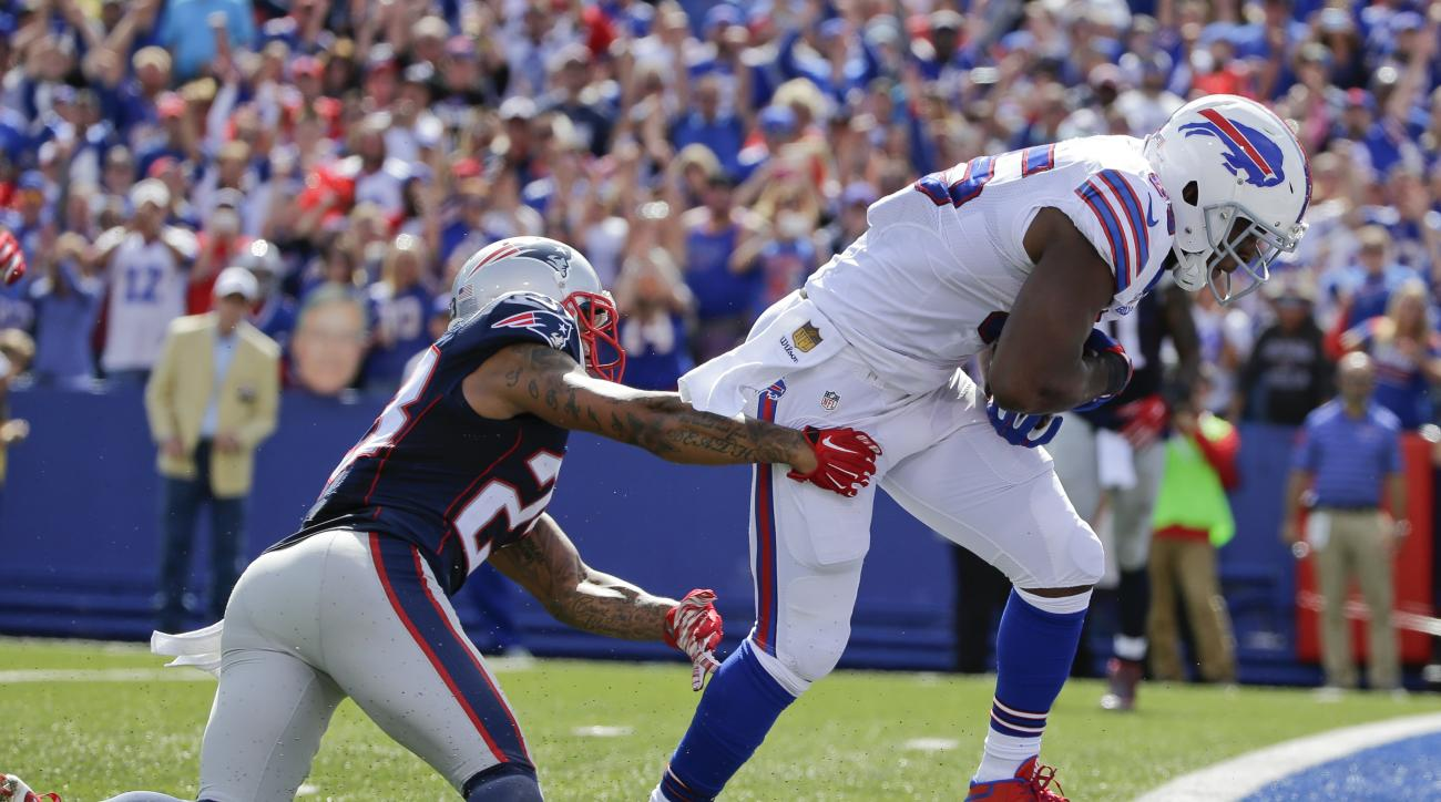 Buffalo Bills tight end Charles Clay (85) breaks a tackle by New England Patriots' Patrick Chung (23) to score a touchdown during the first half of an NFL football game Sunday, Sept. 20, 2015, in Orchard Park, N.Y. (AP Photo/Bill Wippert)
