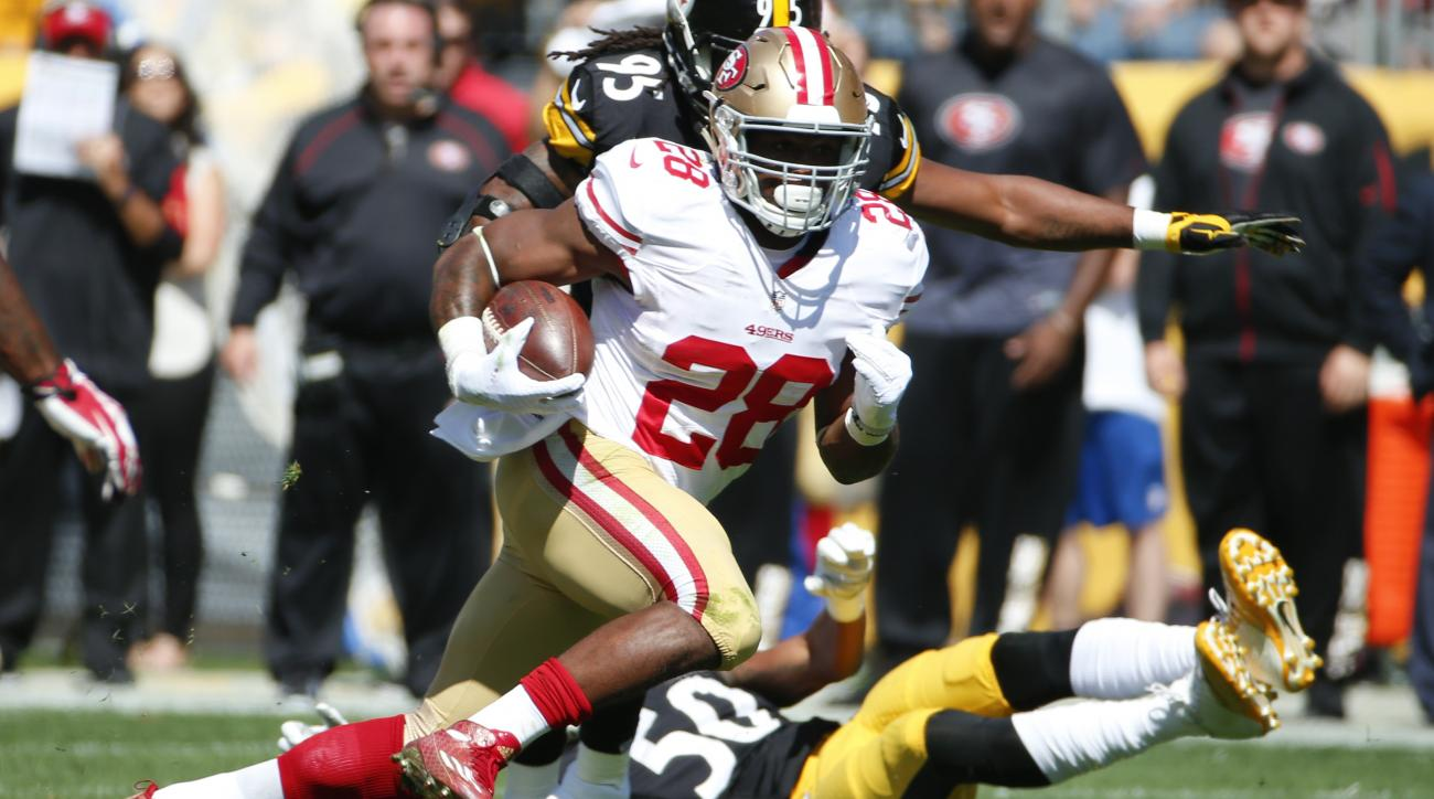 San Francisco 49ers running back Carlos Hyde (28) runs the ball past Pittsburgh Steelers inside linebacker Ryan Shazier (50) in the first quarter of an NFL football game, Sunday, Sept. 20, 2015, in Pittsburgh. (AP Photo/Gene J. Puskar)
