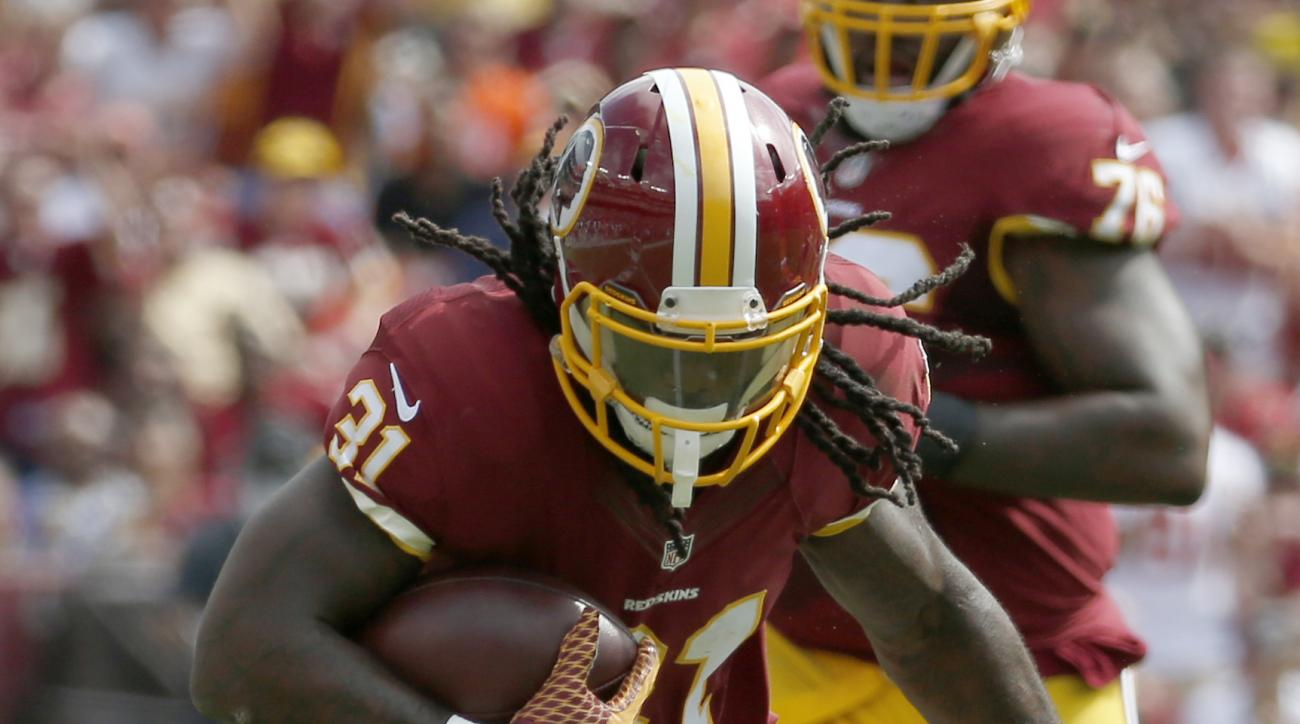 Washington Redskins running back Matt Jones (31) is stopped by St. Louis Rams free safety Rodney McLeod (23) during the first half of an NFL football game in Landover, Md., Sunday, Sept. 20, 2015. (AP Photo/Alex Brandon)