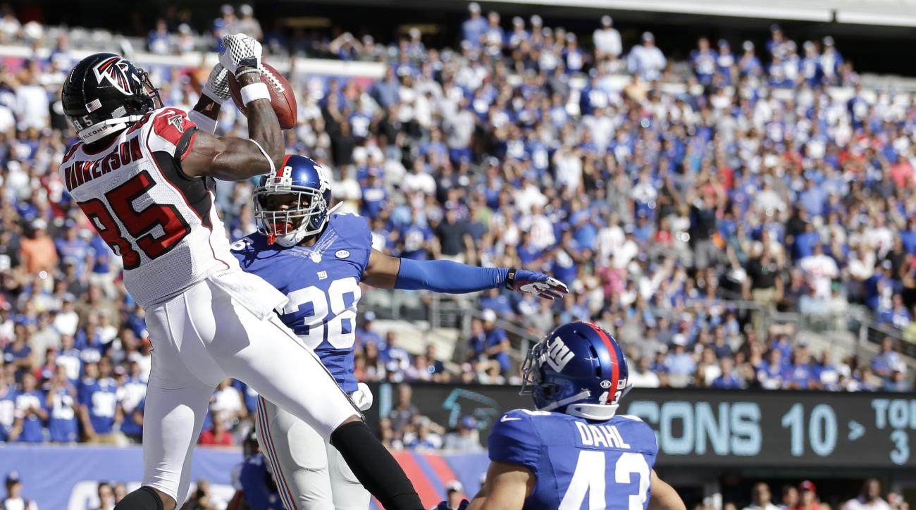 Atlanta Falcons wide receiver Leonard Hankerson, left, makes a touchdown reception on a pass from quarterback Matt Ryan, not pictured, as New York Giants cornerback Trumaine McBride (38) and safety Craig Dahl (43) defend on the play during the second half