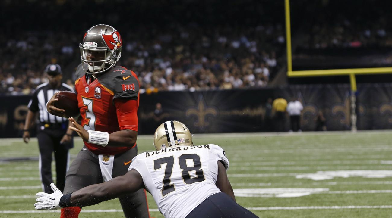 Tampa Bay Buccaneers quarterback Jameis Winston (3) breaks past New Orleans Saints defensive end Bobby Richardson (78) on a touchdown carry in the second half of an NFL football game in New Orleans, Sunday, Sept. 20, 2015. (AP Photo/Jonathan Bachman)