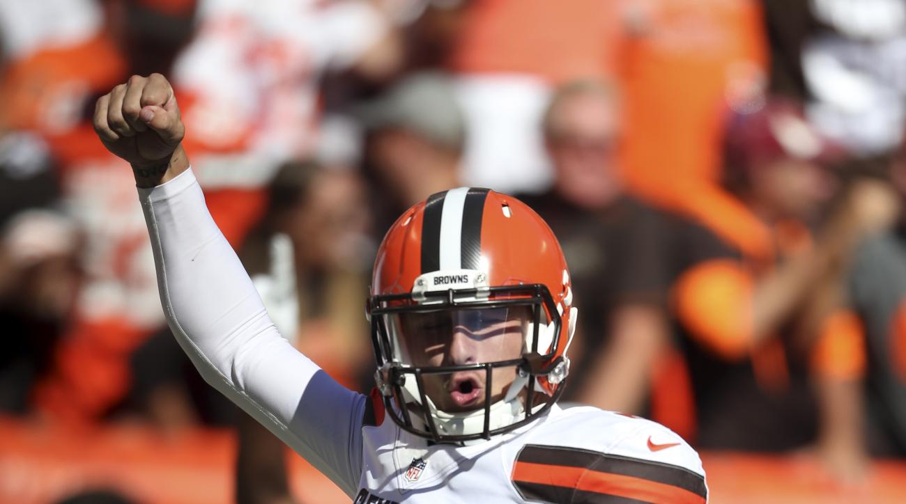 Cleveland Browns quarterback Johnny Manziel pumps his fist after throwing a 50-yard touchdown pass to Travis Benjamin in the second half of an NFL football game against the Tennessee Titans, Sunday, Sept. 20, 2015, in Cleveland. (AP Photo/Ron Schwane)