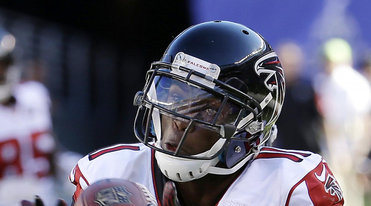 Atlanta Falcons wide receiver Julio Jones (11) makes a catch near the end zone on a pass from quarterback Matt Ryan, not pictured, as New York Giants cornerback Prince Amukamara (20) defends on the play during the second half of an NFL football game, Sund