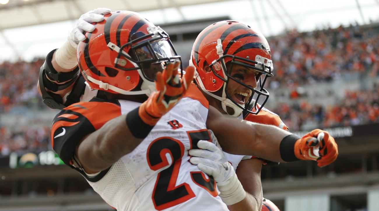 Cincinnati Bengals tight end Tyler Eifert, right, celebrates with running back Giovani Bernard (25) after scoring a touchdown in the second half of an NFL football game against the San Diego Chargers, Sunday, Sept. 20, 2015, in Cincinnati. (AP Photo/Gary