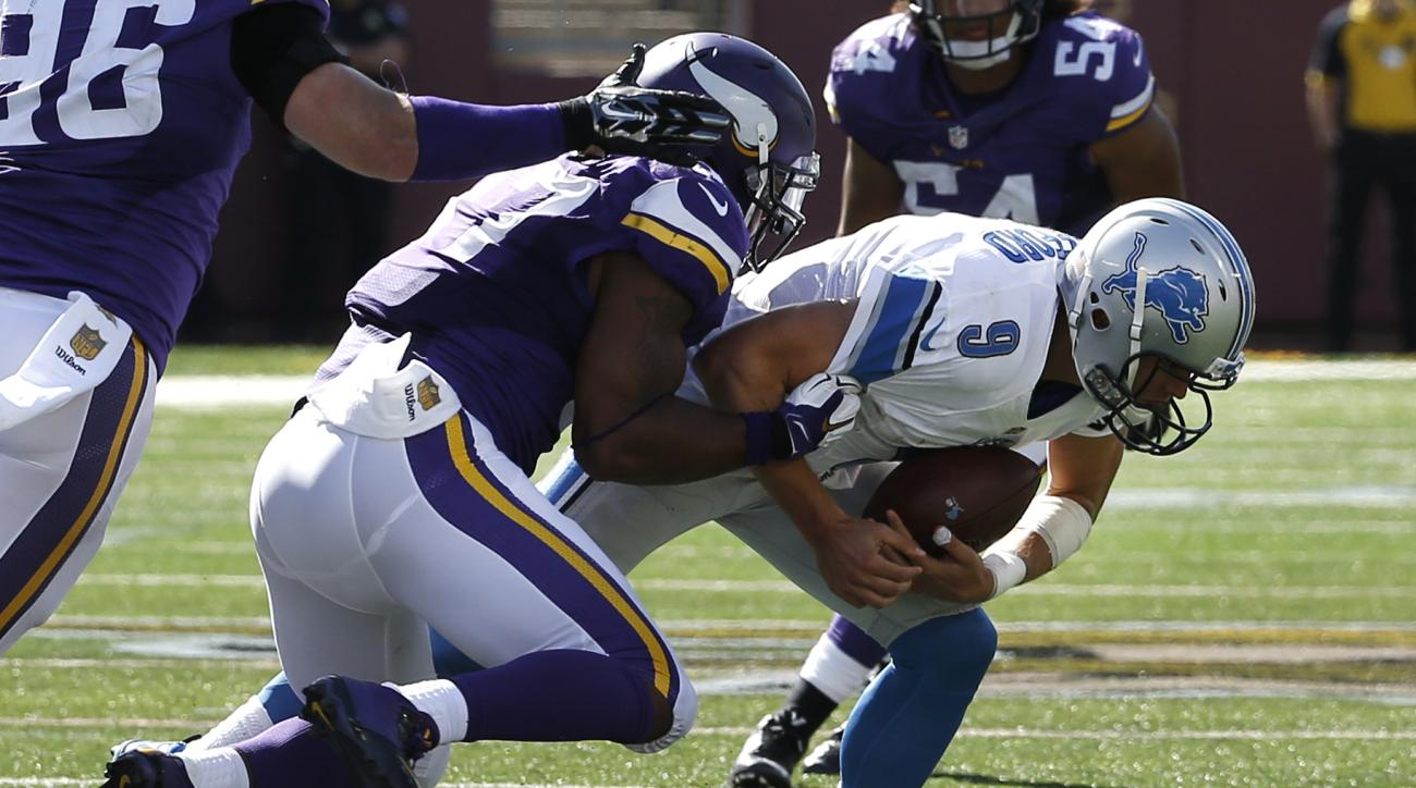 Detroit Lions quarterback Matthew Stafford (9) is sacked by Minnesota Vikings defensive end Everson Griffen in the second half of an NFL football game in Minneapolis, Sunday, Sept. 20, 2015. (AP Photo/Ann Heisenfelt)