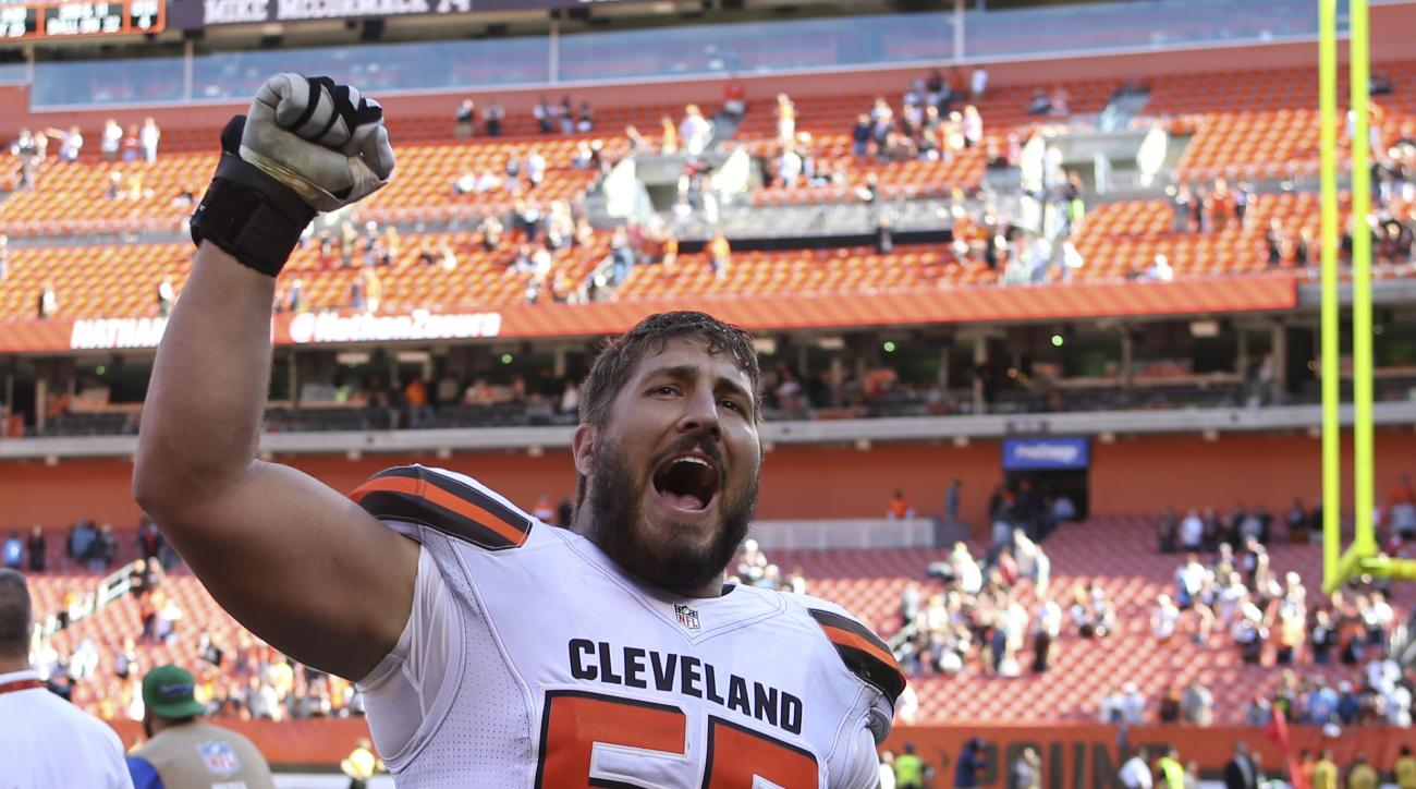 Cleveland Browns center Alex Mack celebrates after the Browns defeated the Tennessee Titans 28-14 in an NFL football game Sunday, Sept. 20, 2015, in Cleveland. (AP Photo/Ron Schwane)