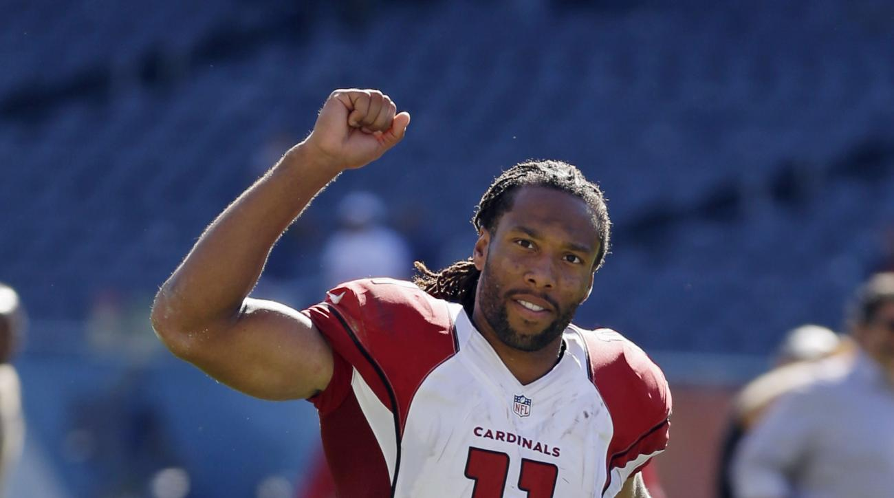 Arizona Cardinals wide receiver Larry Fitzgerald (11) pumps his fist as he runs off the field after an NFL football game against the Chicago Bears, Sunday, Sept. 20, 2015, in Chicago. The Cardinals won 48-23. (AP Photo/Michael Conroy)