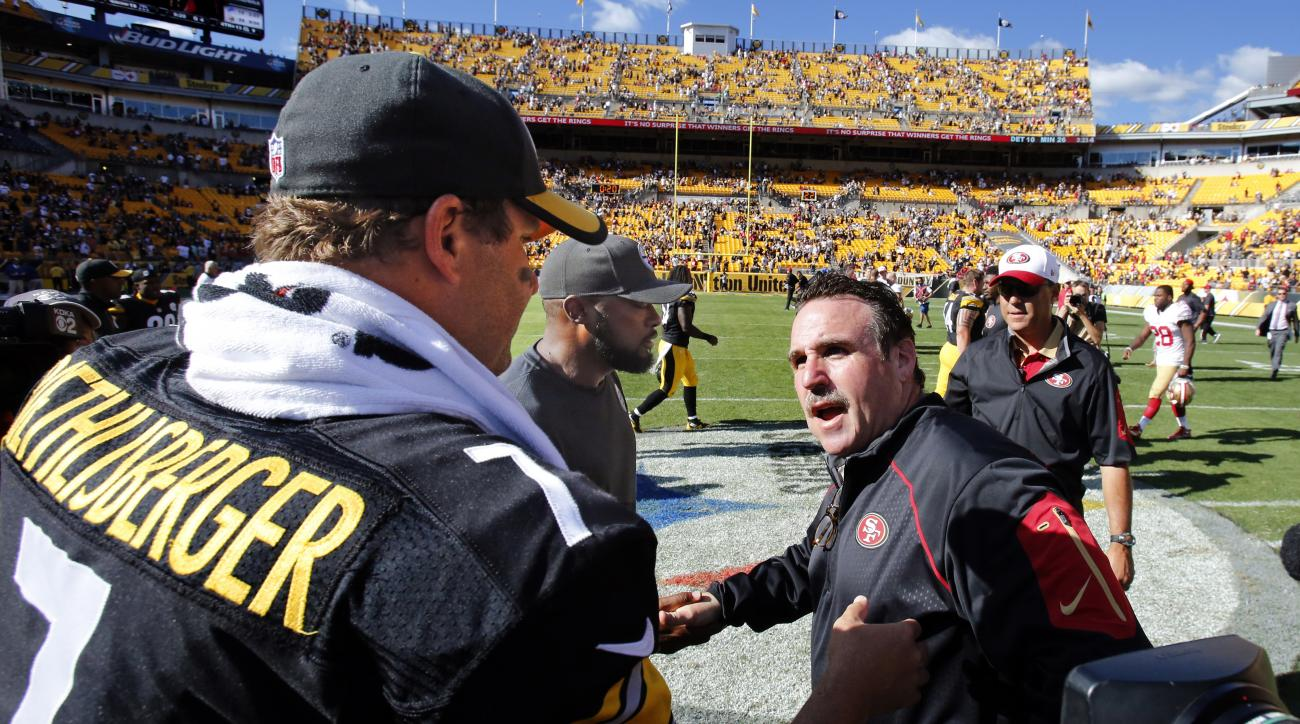 San Francisco 49ers head coach Jim Tomsula, front right, shakes hands with Pittsburgh Steelers head coach Mike Tomlin, center, and quarterback Ben Roethlisberger (7) after an NFL football game in Pittsburgh, Sunday, Sept. 20, 2015. The Steelers won 43-18.