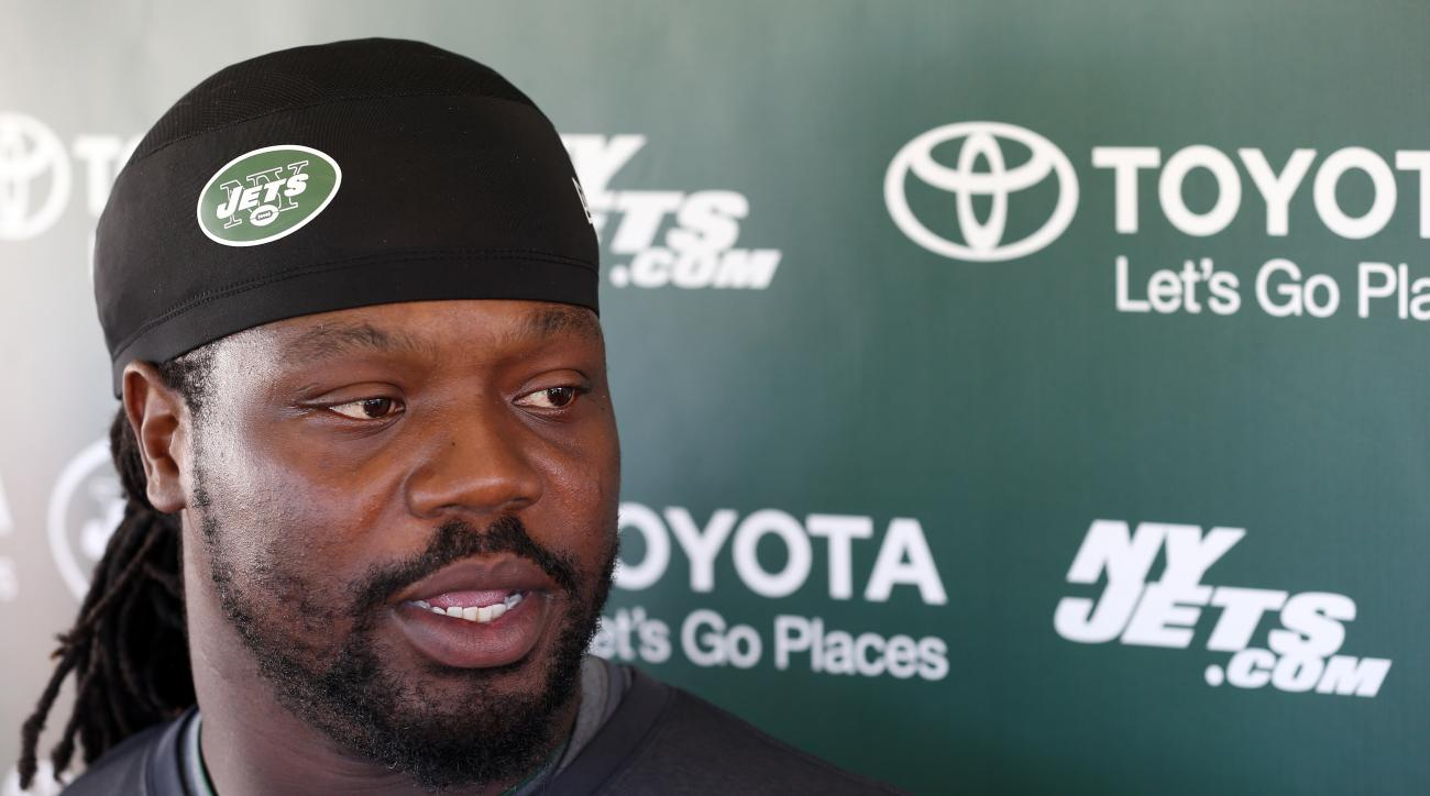 FILE - In this July 31, 2015, file photo, New York Jets nose tackle Damon Harrison talks with reporters at NFL football training camp in Florham Park, N.J. Harrison has made his presence felt on the Jets' defense, working his way from being an undrafted f