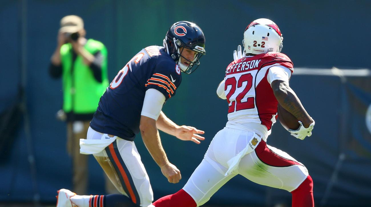 Chicago Bears quarterback Jay Cutler chases Arizona Cardinals strong safety Tony Jefferson after his interception during the second quarter of an NFL football game, Sunday, Sept. 20, 2015 in Chicago. (Steve Lundy/Daily Herald via AP) MANDATORY CREDIT; MAG