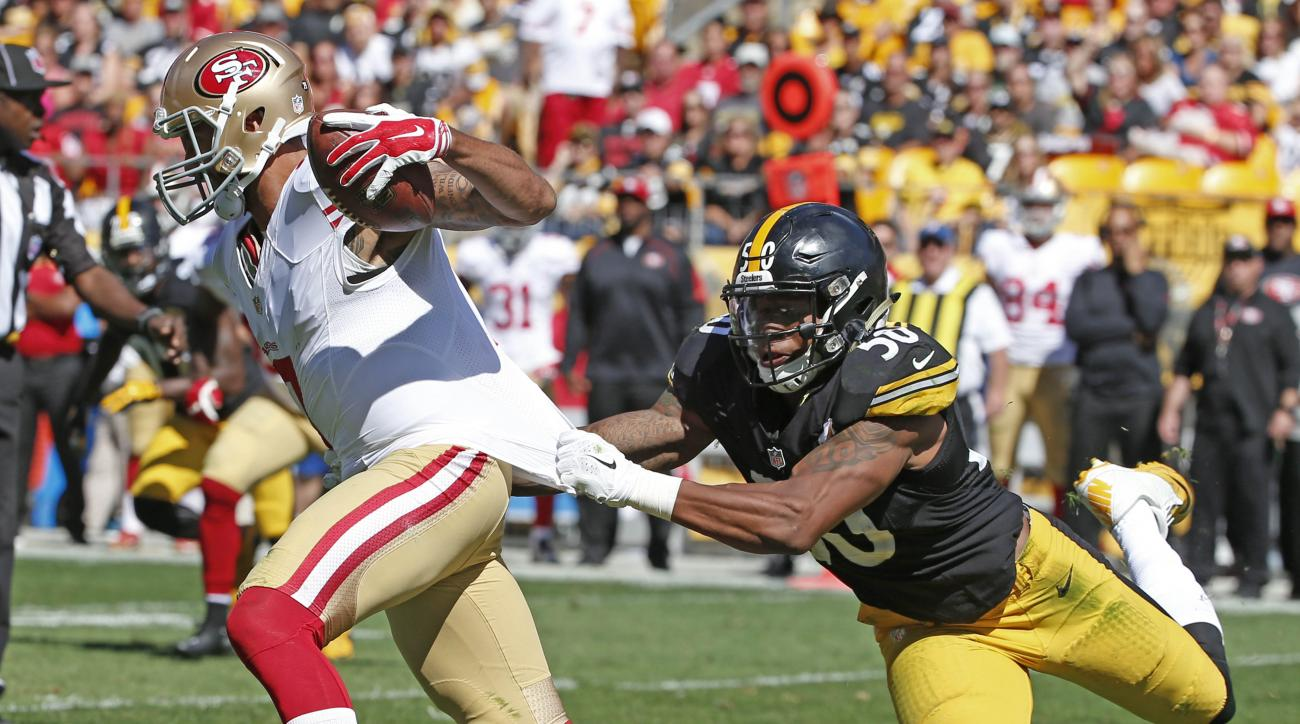 Pittsburgh Steelers inside linebacker Ryan Shazier (50) grabs San Francisco 49ers quarterback Colin Kaepernick (7) by the jersey as he scrambles in the fourth quarter of an NFL football game, Sunday, Sept. 20, 2015, in Pittsburgh. Kaepernick got loose but