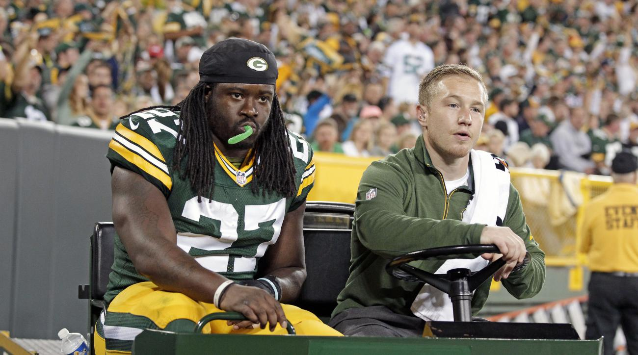 Green Bay Packers running back Eddie Lacy (27) is carted off the field after being injured during an NFL football game against the Seattle Seahawks, Sunday, Sept. 20, 2015 at Lambeau Field in Green Bay, Wis. (Wm. Glasheen/The Post-Crescent via AP) NO SALE