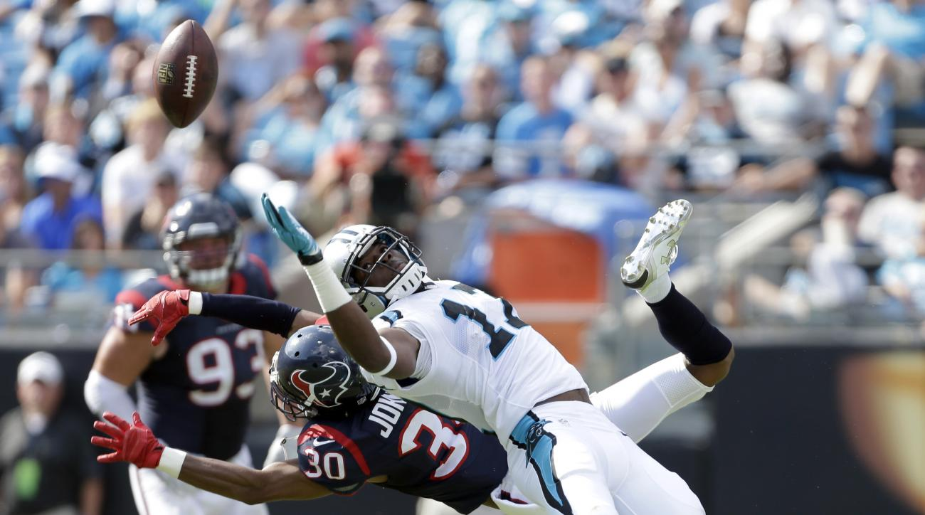 FILE - In this Sunday, Sept. 20, 2015 file photo, Carolina Panthers' Devin Funchess (17) misses a catch as Houston Texans' Kevin Johnson (30) defends during the second half of an NFL football game in Charlotte, N.C.  Carolina Panthers quarterback Cam Newt