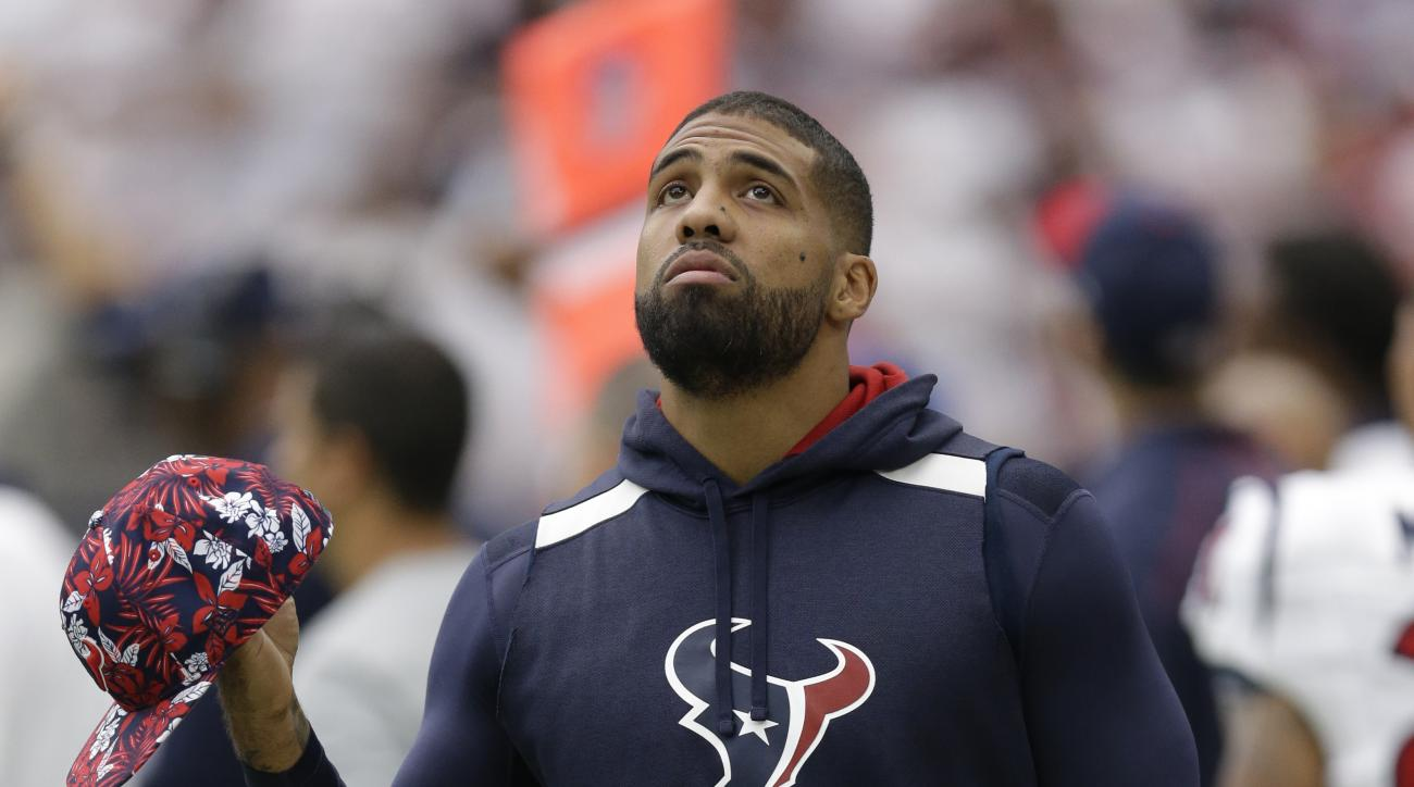 Houston Texans running back Arian Foster, who is not playing due to injury, walks the sidelines during the first half of an NFL football game Sunday, Sept. 13, 2015, in Houston. (AP Photo/Patric Schneider)