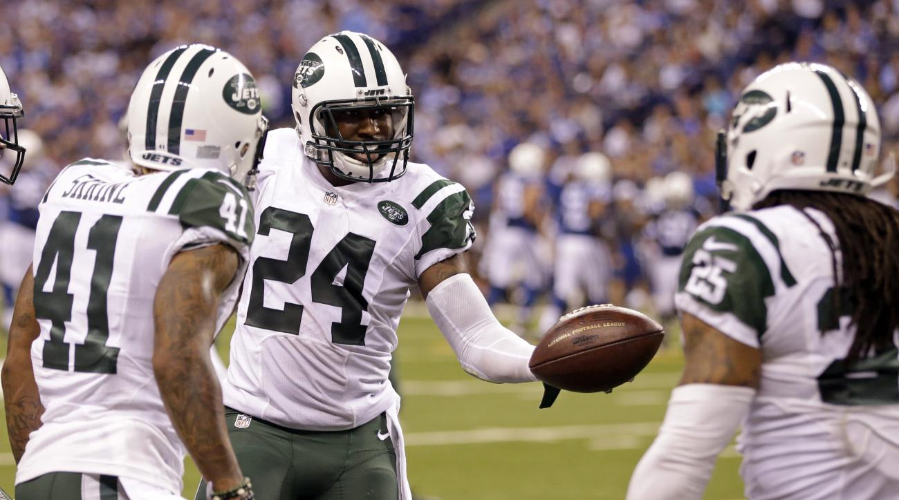 New York Jets cornerback Darrelle Revis (24) celebrates an interception with defensive back Buster Skrine (41) and free safety Calvin Pryor (25) in the second half of an NFL football game against the Indianapolis Colts in Indianapolis, Monday, Sept. 21, 2