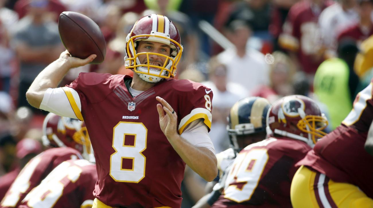 FILE - In this Sunday, Sept. 20, 2015, file phot, Washington Redskins quarterback Kirk Cousins (8) throws a pass during the first half of an NFL football game against the St. Louis Rams in Landover, Md. Successful on third downs, efficient as can be and,