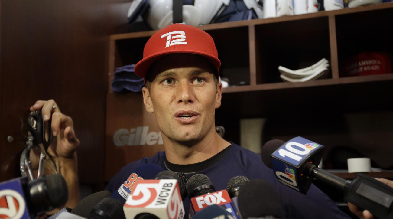 New England Patriots quarterback Tom Brady speaks with reporters in the locker room  before NFL football practice at Gillette Stadium, Wednesday, Sept. 23, 2015, in Foxborough, Mass. (AP Photo/Steven Senne)