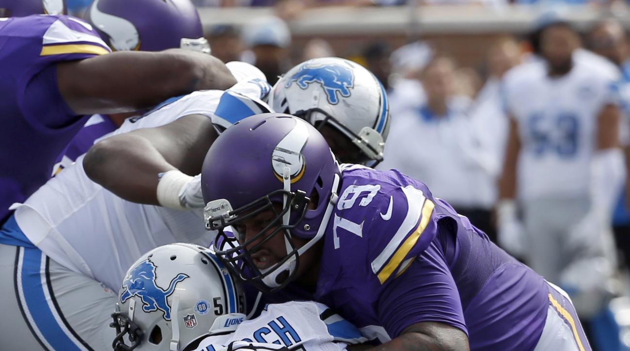 In this Sept. 20, 2015, file photo, Minnesota Vikings guard Mike Harris keeps Detroit Lions linebacker Stephen Tulloch (55) away from the play during the first half of an NFL football game in Minneapolis. Harris had made sure the Vikings haven't had to wo