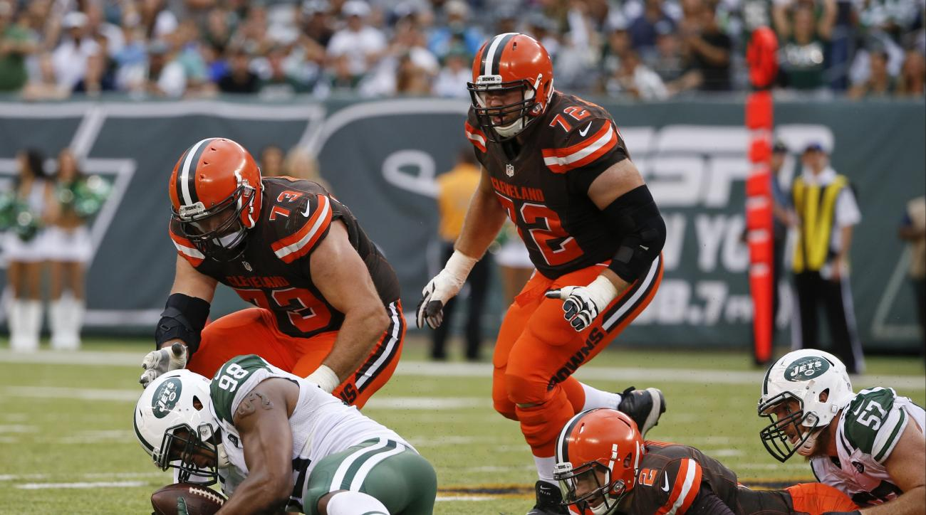 FILE - In this Sept. 13, 2015, file photo, New York Jets outside linebacker Quinton Coples (98) recovers the ball fumbled by Cleveland Browns quarterback Johnny Manziel (2) on a sack by teammate Trevor Reilly (57) during the second half of an NFL football