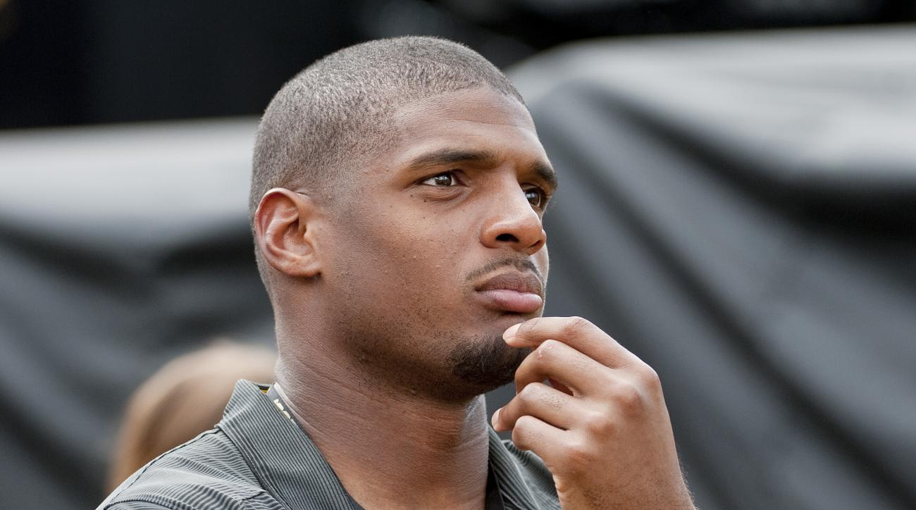 Former Missouri player Michael Sam watches pregame festivities before the start of the South Dakota State-Missouri NCAA college football game Saturday, Aug. 30, 2014, in Columbia, Mo. The St. Louis Rams cut Michael Sam, the first openly gay player drafted