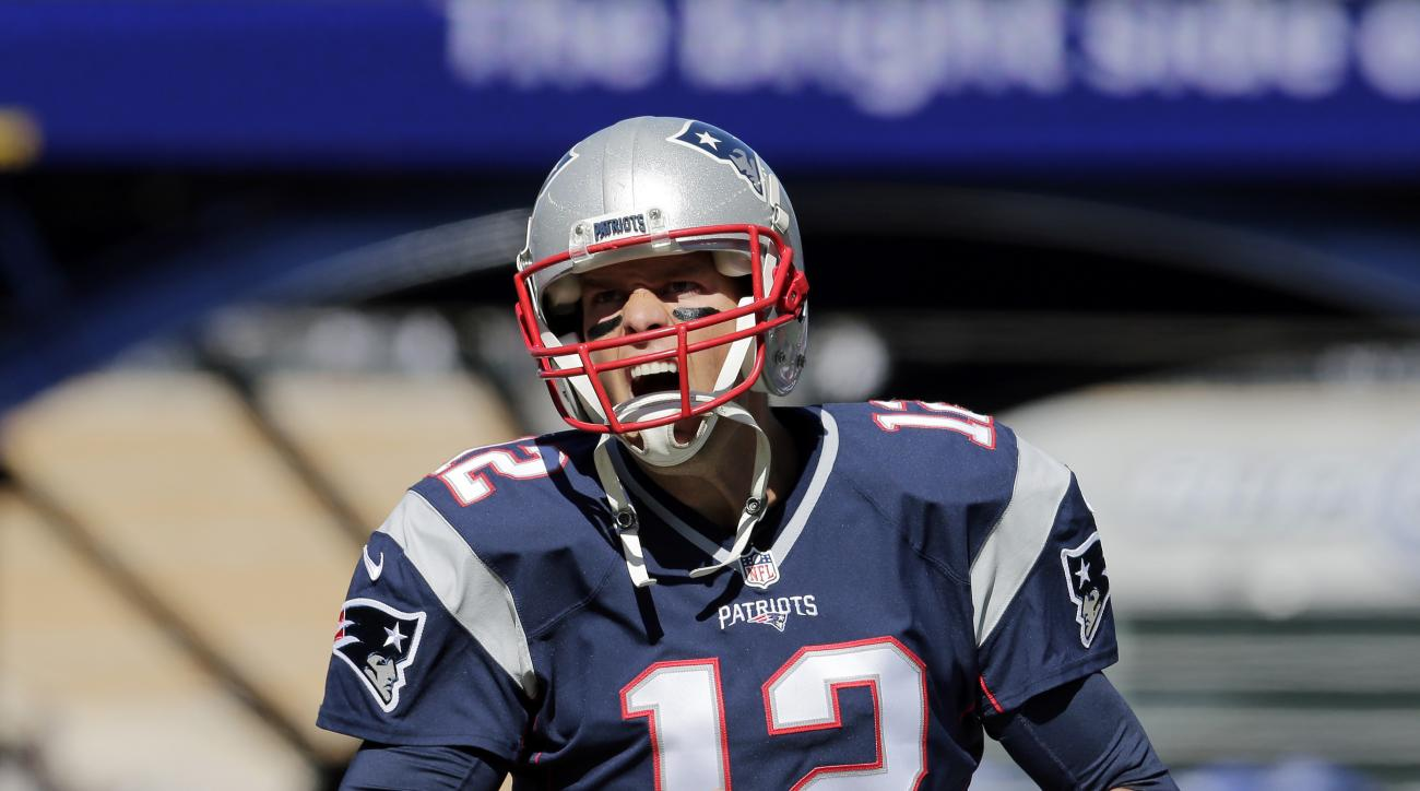 New England Patriots quarterback Tom Brady  takes the field to warm up before an NFL football game against the Jacksonville Jaguars, Sunday, Sept. 27, 2015, in Foxborough, Mass. (AP Photo/Charles Krupa)